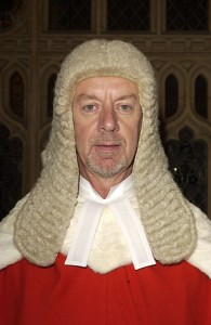 The Hon Mr Justice Wood